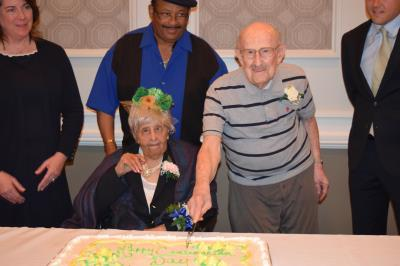 Agnes Nelson, 108, of Broomall Rehabilitation & Nursing Center in Marple Township and Sye Brandman, 103, of Philadelphia, oldest party guests, cut the ceremonial birthday cake.