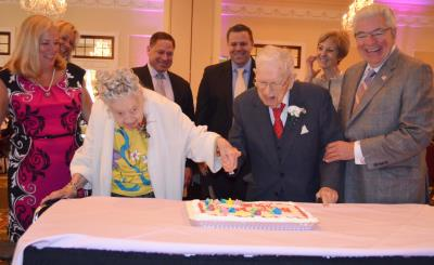 Marion Roth, 106, and Fred J. Mack Jr., 104, cut the centenarian birthday cake.