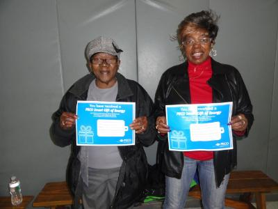 Doris Burgess (left), of Lansdowne, and Betty Whitehead (right) of Drexel Hill, display their raffle prizes- $125 PECO vouchers to be used toward utility payment.