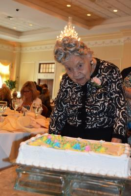 Marion Roth, of White Horse Village in Newtown Square, age 107, cuts the ceremonial birthday cake. Ms. Roth was the oldest celebrant in attendance.