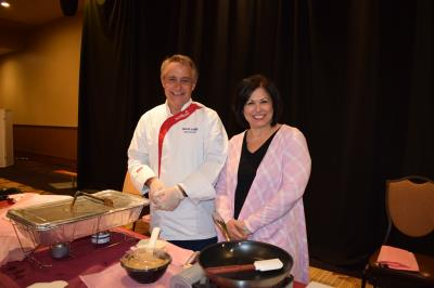 Mercy Fitzgerald sponsored a cooking demo with Executive Chef, David Judge,  who prepared a Mediterranean Chicken Taco on a warm flour tortilla. Pictured are Chef David Judge and Laureen Carlin, of Mercy Fitzgerald.