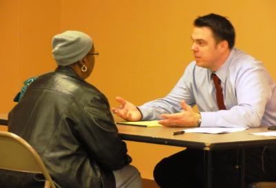 Christopher Murphy, elder law attorney from Pappano & Breslin law firm, meets with client.