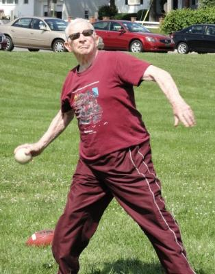 Tom Rice hurls the softball in Track and Field's softball throw.