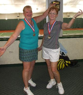Tennis medalists strike a pose.