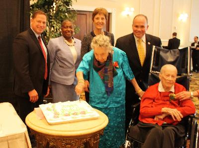 David White, County Council member; Denise V. Stewart, Director of COSA; Marianne Grace, Delaware County Executive Director; John McBlain, County Council member; with Marion Roth, 105, of White Horse Village in Newtown, and Catherine Nackenoff, 105, of Granite Farms Estates in Middletown.