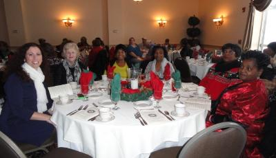 Foster grandparents and guests enjoy the luncheon.