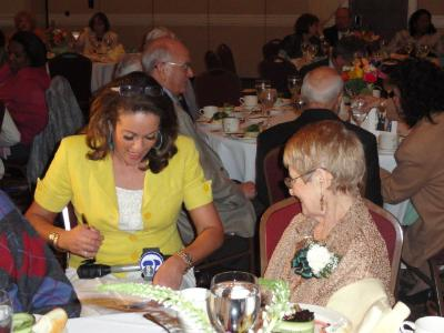 Lisa Thomas-Laury of Channel 6 News conducts an interview with Mae Verga,99, at the 2013 Delaware County Centenarian Luncheon.