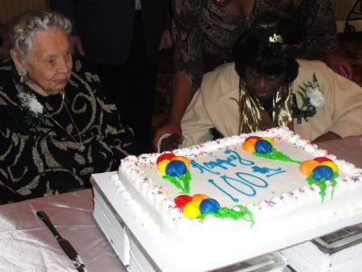Marion Roth, of White Horse Village,who will turn 105 on November 11 and Nancy Fisher, of Manor Care Yeadon, who will turn 109 on December 23 with the birthday cake honoring all 2013 Delaware County centenarians.