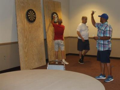 Greg Thomas shoots Darts at the Senior Games Darts Exhibition.