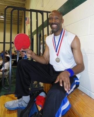 Dwan Hunt with his gold medal in Men's Singles Table Tennis.