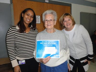 Christy Bobo (left), Housing Director at COSA, raffle winner Jeane Brower (center), of Brookhaven, and Joana Geiger (right) Link coordinator.