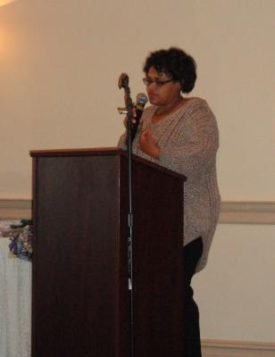 Alisha Knight, Project Director, welcomes grandparents and guests to the luncheon.