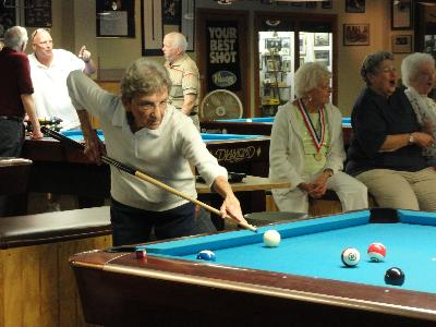 Lining up the shot in Women's Billiards