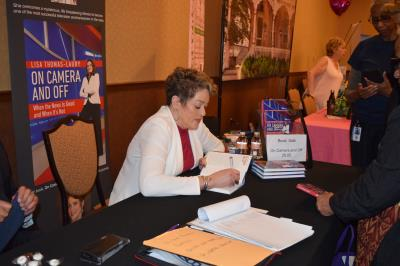 Special guest, Lisa Thomas-Laury, signs copies of her book.