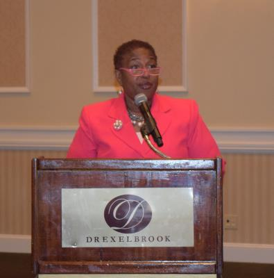 Denise V. Stewart, Director of the County Office of Services for the Aging, addresses the guests.