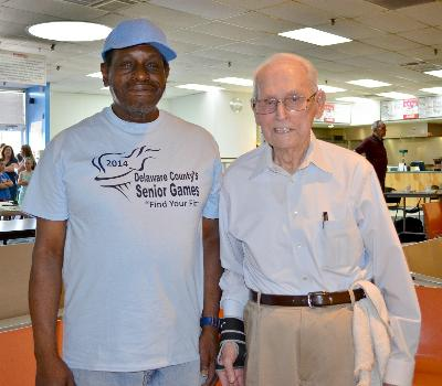 Ronald Worthy and partner,Richard Bayley, compete in Double's Bowling.