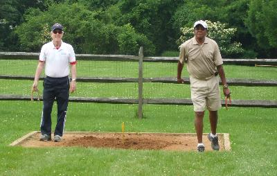 John Durning and Ernie Brown compete in Men's Horseshoes.