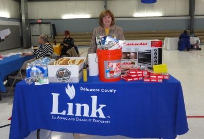Joanna Geiger, ADRC Coordinator, displays some of the raffle prizes at the Energy Fair.  The Delaware County Link to Aging and Disability Resource Center sponsored the Energy Fair.