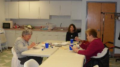 Loved ones create mosaics while their caregivers listen to Dr. Barry Jacobs, Psy.D.