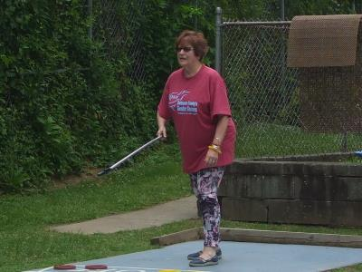 Elizabeth Hermansen competes in Shuffleboard at Ridley Township Swim Club