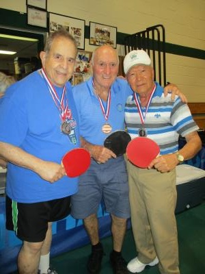 Table Tennis medalists: Alan Kutner, Dave Hirst, and Esteban Abarintos