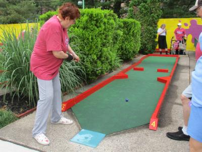 June Robbins looking for a hole in one at Miniature Golf at Putt-Putt Fun Center!