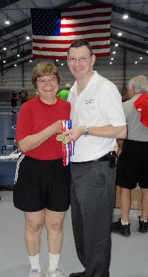 Linda Zappacosta, of Chester, is presented her gold medal in Women's Basketball by Stephen Gamble, co-chair of the Delaware County Senior Games.