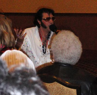 Elvis entertains the crowd, courtesy of Heron Companions.