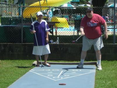John Dang and Ray Young Jr. compete in Shuffleboard