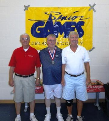 Bob Ballantine, Senior Games commitee member;J.Gym McKeone, of Media with his silver medal in Men's Singles Pickleball; and Burr Daly, Senior Games committee member.