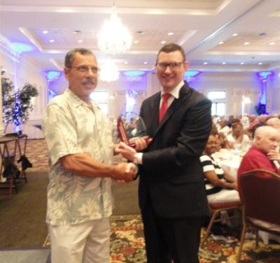 Fit for Life winner, John Iannotti, is presented his award by Stephen Gamble, co-chair of the Delaware County Senior Games.