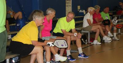 Discussing strategy at Pickleball