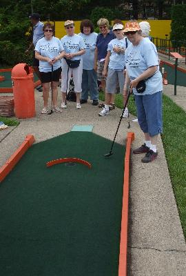 Anna Browne hopes for a hole-in-one in Miniature Golf at Putt Putt.