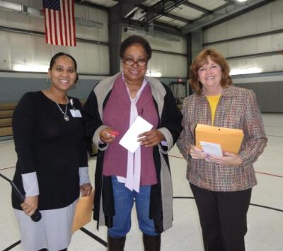 LaVergn Reid (center), of Chester, displays her winning home heating oil voucher from American Energy Supply and Services. The oil voucher was one of many prizes raffled at the Energy Fair sponsored by the Delaware County Link to Aging and Disability Resources (ADRC). Also pictured are: