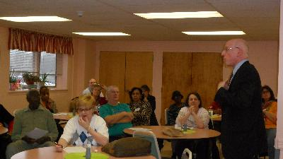 "Caregivers listen as Dr. Barry Jacobs, Psy.D. presents ""Communication Strategies for Managing Difficult Behaviors."""