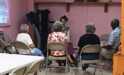 Care receivers participate in a fitness activity with Frannie Schmerling, Certified Recreational Therapist with Senior Center at Home.