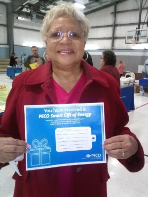 Barbara Johnson, of Upper Chichester, displays her prize-a $125 PECO voucher to be used toward utility payment.