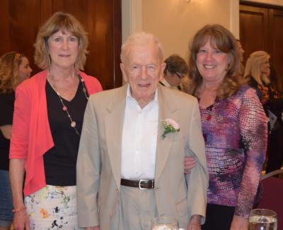 center: Eugene Vickers, age 103