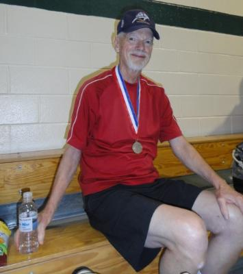 Taking a rest after a touch medal-winning match